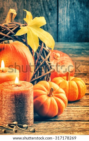 Autumn still-life with pumpkins and candles - stock photo