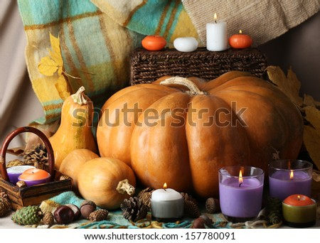 Autumn still life with pumpkins on fabric background - stock photo
