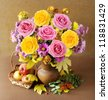 Autumn still life with roses bunch and fruits on artistic background - stock photo