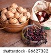 Autumn Still-Life with Walnut , Elderberry and Chestnut - stock photo