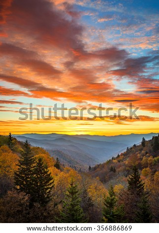Autumn sunrise and dramatic sky over Oconaluftee overlook in the Smoky Mountains - stock photo