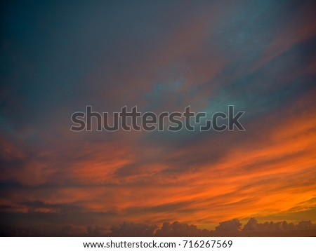 Autumn Sunset Above Honolulu.  Fall colors of orange, red, pink, blue and gray/grey in a vibrant sunset photograph.