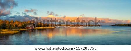 Autumn sunset at the Baltic sea coastline, panorama - stock photo