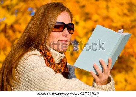Autumn sunset country - red hair woman read book - stock photo