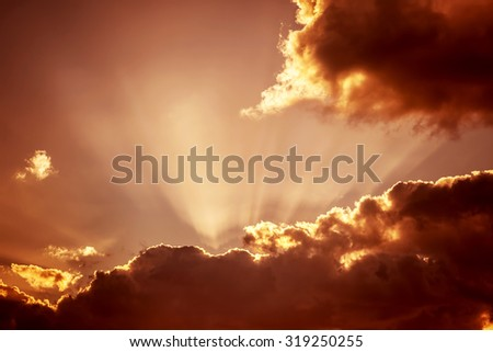 Autumn sunset sky background, beautiful dramatic brown cloudscape, amazing view, beauty of overcast nature  - stock photo