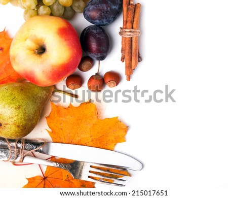 Autumn table setting with leaves, apples, plums and pears - stock photo