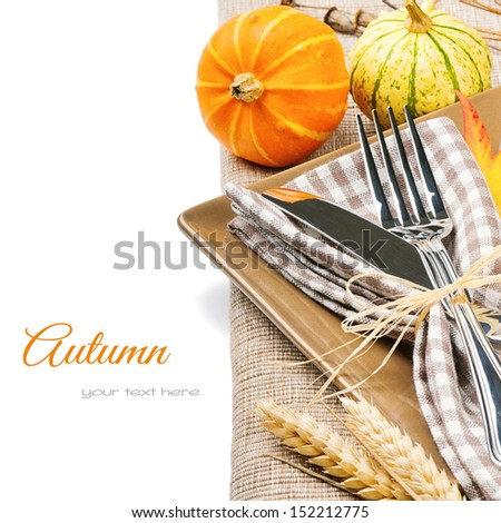Autumn table setting with pumpkins isolated over white - stock photo