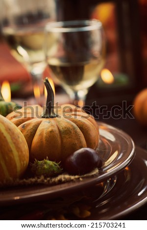 Autumn table setting with pumpkins.  Thanksgiving dinner and autumn decoration. - stock photo