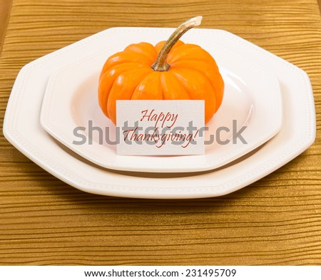 Autumn Thanksgiving dinner table setting with decorative pumpkin. - stock photo
