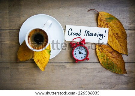 Autumn time, cup of coffee, yellow autumnal leaves and notes - stock photo