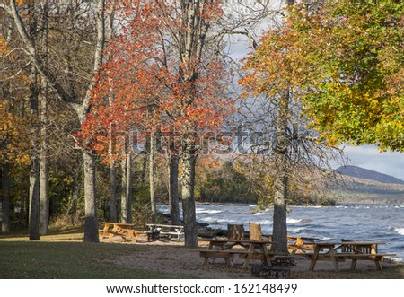 Autumn trees and picnic area by lake