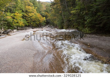Autumn Trees at fall time at The Basin in New Hampshire - stock photo
