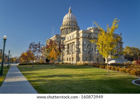 Autumn trees surrounds the capital building in Boise Idaho - stock photo