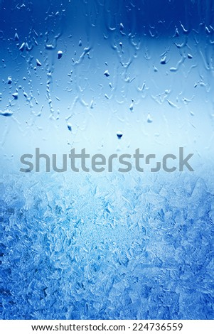 Autumn turn to winter, freezing water on window - stock photo