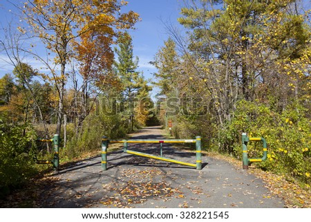 Autumn view of the Ashuwillticook rail to trail in the Berkshire Mountains of Western Massachusetts.