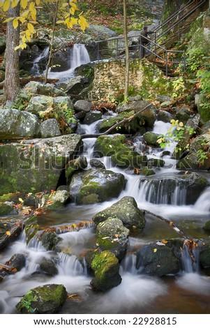 Autumn waterfall scene in the mountains. - stock photo