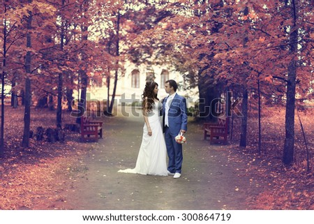 autumn wedding in the park bride and groom in a white dress