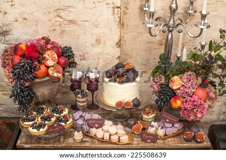 Autumn wedding sweet bar. Cake, cupcakes, sweetness and flowers.