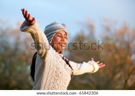 Autumn woman at the park with arms open ? outdoors - stock photo