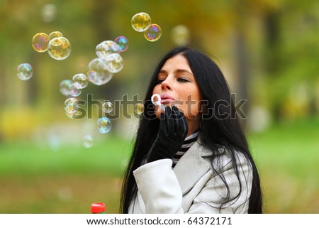 autumn woman blow bubbles - stock photo