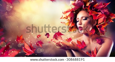 Autumn woman blowing red leaves - Beauty Fashion Model Girl  - stock photo