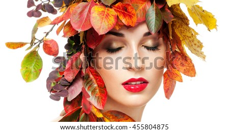 Autumn Woman Fashion Portrait. Beautiful Model Girl with colourful autumn leaves hairstyle. Autumn leaves Hair.