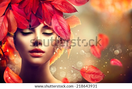 Autumn Woman Fashion Portrait. Fall. Beautiful Model Girl with colourful autumn leaves hairstyle. Fashion Art design with copy space for your text