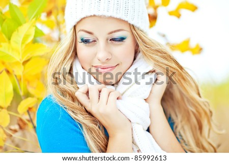 Autumn woman having fun at the park and smiling - stock photo