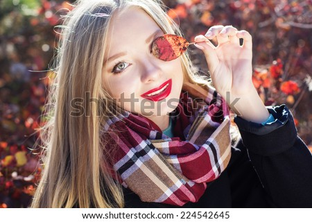 Autumn woman in colorful red leaves - stock photo