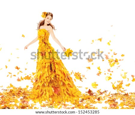 Autumn woman in fashion dress of yellow maple leaves holding bouquet leaf.  - stock photo