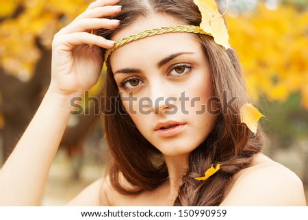 Autumn woman on leafs background - stock photo