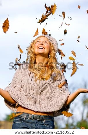 autumn woman smiling and having fun outdoors - stock photo