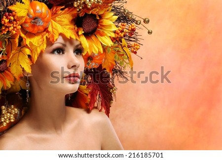 Autumn Woman with Fall Leaves. Portrait of Fashion Girl with Decorated Hairstyle. - stock photo