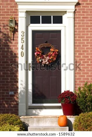 autumn wreath on door - stock photo
