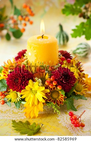 autumn wreath with yellow candle and flowers - stock photo
