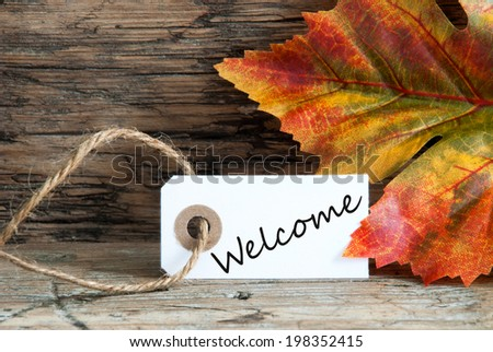Autumnal Background with Welcome written on a white Label - stock photo