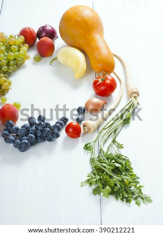 autumnal fruits and vegetables on white wooden table