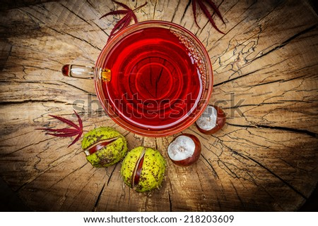 autumnal tea with chestnuts - stock photo