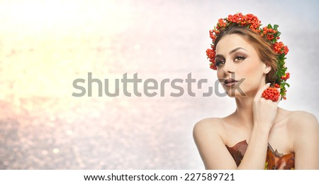 Autumnal woman. Beautiful creative makeup and hair style in fall concept studio shot. Beauty fashion model girl with autumnal make up and hair style. Fall. Creative Autumn makeup. Gorgeous redhead. - stock photo
