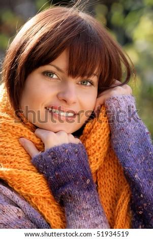 Autumnal woman wearing scarf - stock photo