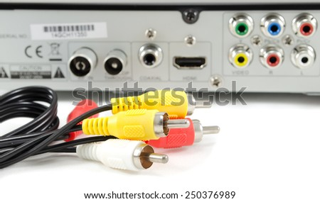 AV cable against background of VCR powerboard - stock photo
