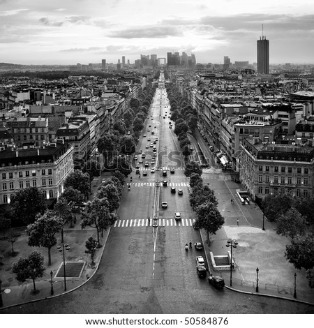 Av. de la Grande Armee, Paris, France. View from the top of the Arc de Triomphe; sunset. - stock photo