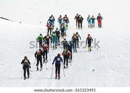 AVACHA AND KORYAKSKY VOLCANOES, KAMCHATKA, RUSSIA - APRIL 27, 2014: Group of ski mountaineers raised the Avacha Volcano. Team Race ski mountaineering Asian, ISMF, Russian, Kamchatka Championship. - stock photo