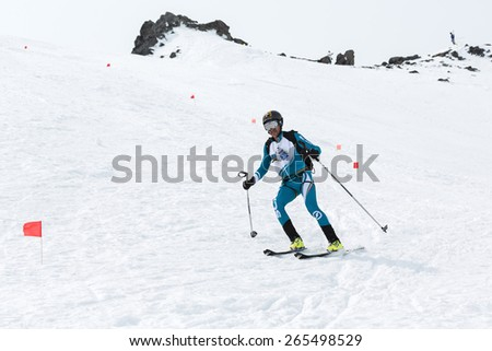 AVACHA, KORYAK VOLCANOES, KAMCHATKA, RUSSIA - APRIL 27, 2014: Ski mountaineer Kurchakov Viacheslav rides from volcano. Team Race ski mountaineering Asian, ISMF, Russian, Kamchatka Championship. - stock photo