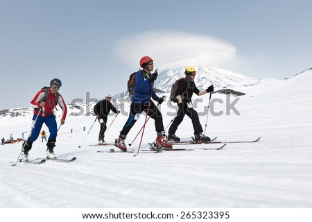AVACHA, KORYAK VOLCANOES, KAMCHATKA, RUSSIA - APRIL 27, 2014: Ski mountaineers climb on skis on mountain. Team Race ski mountaineering Asian, ISMF, Russian, Kamchatka Championship. - stock photo
