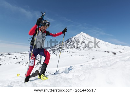 AVACHA VOLCANO, KAMCHATKA, RUSSIA - APRIL 26, 2014: Ski mountaineer Kurchakov Vyacheslav climbs on Avachinskiy Volcano. Individual race ski mountaineering Asian, ISMF, Russian, Kamchatka Championship. - stock photo