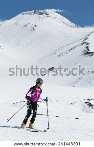 AVACHA VOLCANO, KAMCHATKA, RUSSIA - APRIL 26, 2014: Ski mountaineer Sorvinkova Tatiana  rides on skis from Avachinsky Volcano. Ski mountaineering Asian, ISMF, Russian, Kamchatka Championship. - stock photo