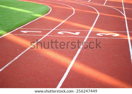 Available for extended license use/1 2 3 on a running track finish line - stock photo