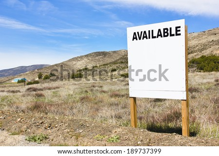 Available sign posted in a rural scene.  - stock photo