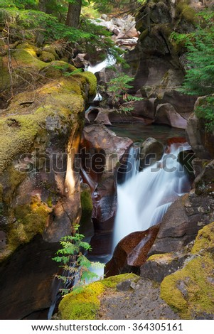 Avalanche Gorge cascade waterfall Glacier National Park - stock photo